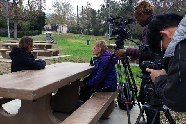 UCLA professor Ursula Heise, at right, interviews Karen Mabb, U.S. Navy biologist, about the Green-cheeked parrot.