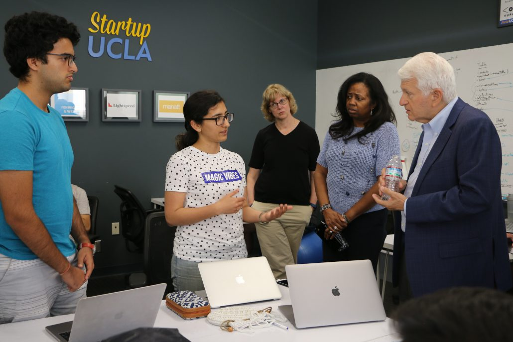 Chancellor Block speaks with accelerator students Bhupendra Chaudhary and Sonali Galhotra MBA '18