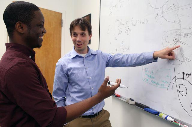 Photo of Postdoctoral scientist Adeyemi Adebiyi and Jasper Kok, associate professor of atmospheric and oceanic sciences.