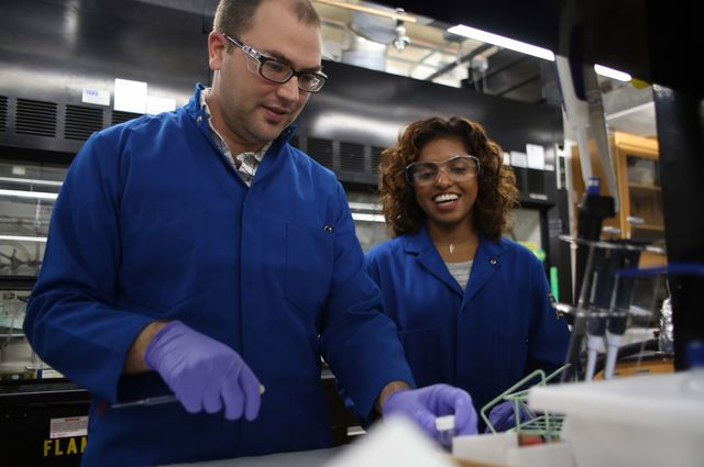 Photo of Justin Caram, assistant professor of chemistry and biochemistry in the UCLA College, and graduate student Dayanni Bhagwandin.