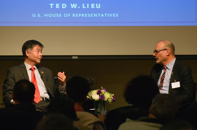 U.S. Rep. Ted Lieu speaks with UCLA professor Abel Valenzuela during an audience Q&A following the Winston C. Doby lecture.