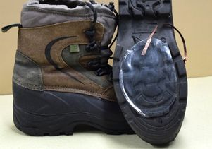 Hiking shoe with device attached