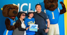 Josie and Joe Bruin welcome one of the newest Bruins.