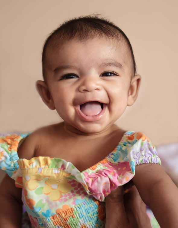 Photograph of baby laughing