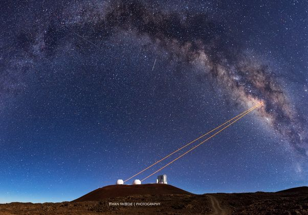 Photo of telescope pointing to the sky.