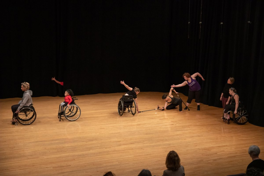 Photo of a group of dancers performing on stage,