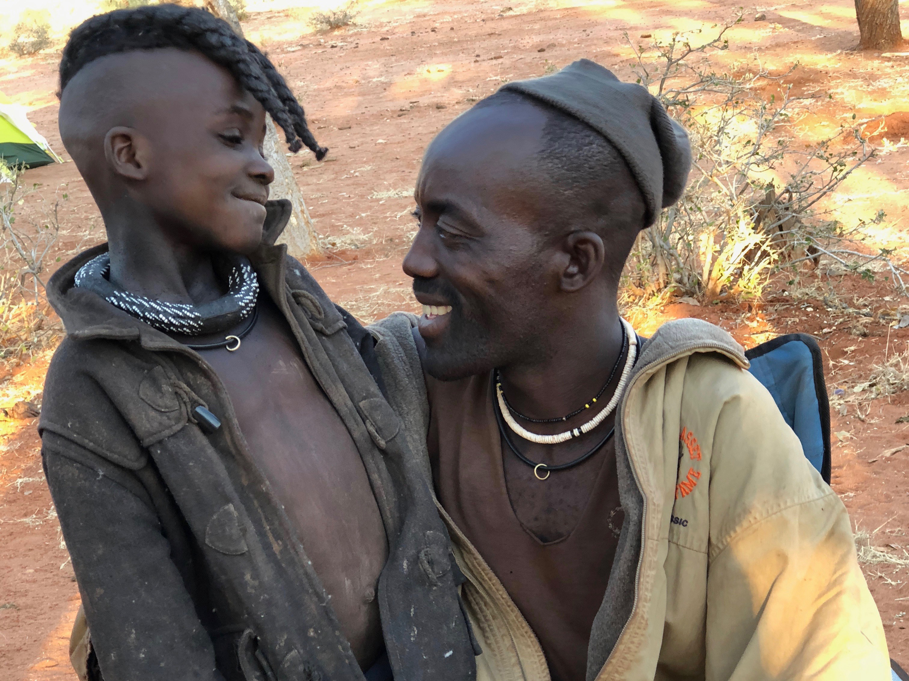 A photo of a Himba father and son.
