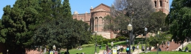 A photo of students on the UCLA campus, with the Janss Steps and Royce Hall in the background.