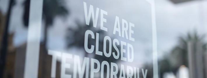 """A photo of a storefront with a sign that says """"We are closed temporarily."""""""