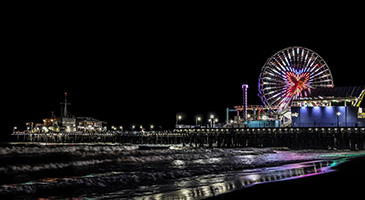 A photo of the Santa Monica Pier at night.