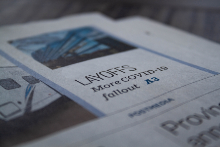 A photo of an article in the newspaper detailing the layoffs that continue to happen around the world.