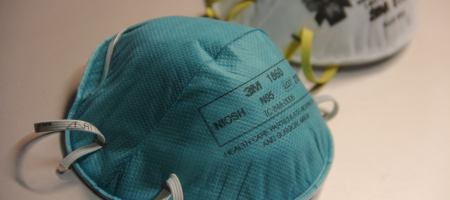 A photo of two N95 respirators.