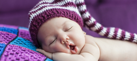 A photo of a sleeping baby.