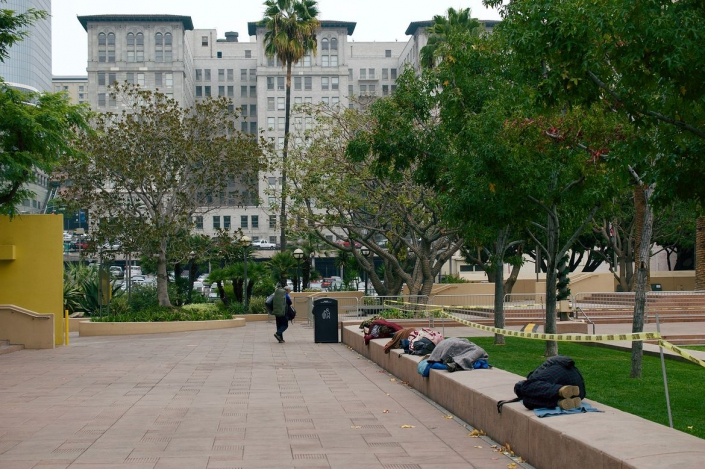 A photo of people sleeping at Pershing Square in downtown Los Angeles
