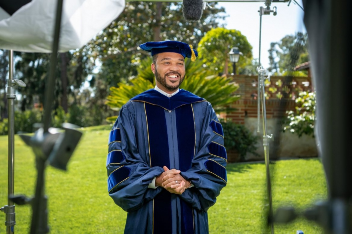 A photo of D'Artagnan Scorza filming his address to the UCLA College's class of 2021.