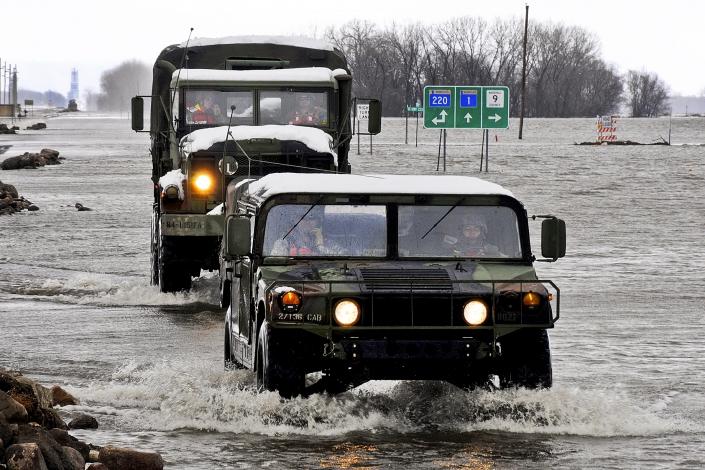 Military vehicles traveling through a flooded street in Minnesota. Photo Credit: Tech. Sgt. Erik Gudmundson/U.S. Air Force
